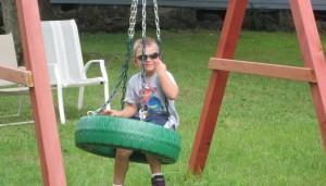 Having Fun on Tire Swing Set